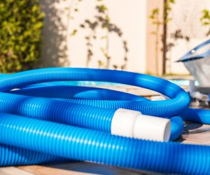 Blue plastic hose for cleaning a swimming pool, Yesulskaya, Krasnodar, Russia. Close-up