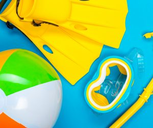 beach accessories on color background. Top view.